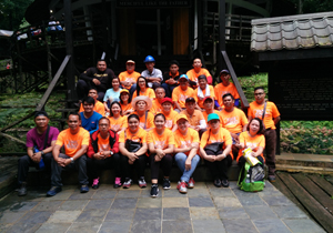 Employees hike uphill to help church