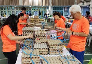 Caring CMS employees at the Sarawak Society for the Deaf Charity Food Fair